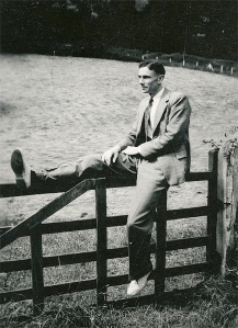 William Marsh sitting on a countryside gate in England on his return from the War